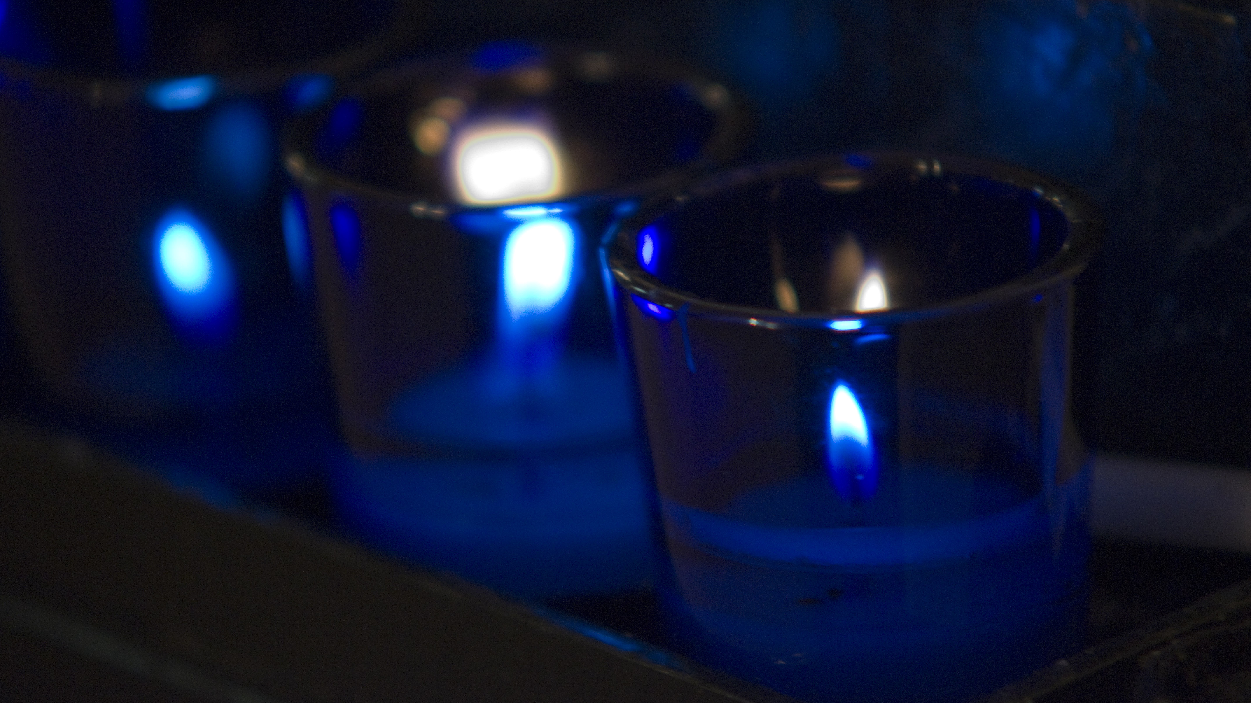 Photo of blue votive candles