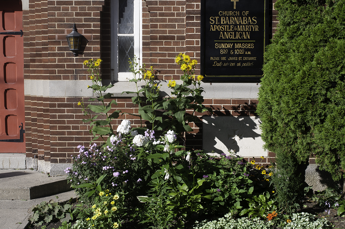 Photo showing front of church with flowers